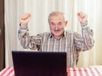 old elderly man using PC